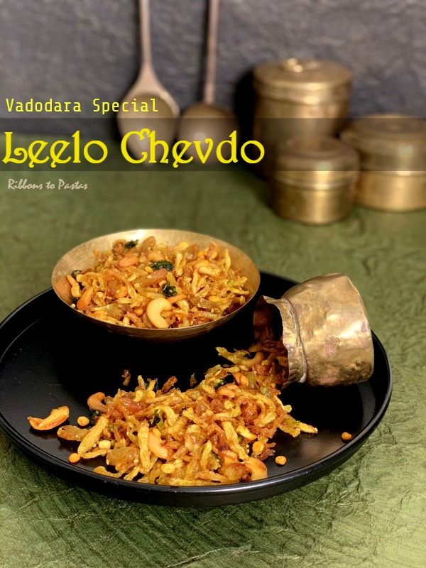 Leelo Chevdo is a special potato based namkeen and is a speciality of Vadodara . Vadodara is the second largest city of Gujarat and the word Leelo literally means wet and chevdo is a farsan or a namkeen . I am sure you must be wondering how a namkeen can be wet , they are supposed to be crunchy . This is exactly what I thought the first time I saw it . It is strange , but a truth that I first tasted this namkeen in London. It is a speciality of Gujarat but I had never heard about it or tasted it. Let me tell you about this unique namkeen. The farsan , as the Gujju's call it is made with grated potatoes . You need to grate them on the thicker side and then immerse them into water. This way they do not charge the colour. After giving them a good wash , all the water is drained and the grated potatoes are spread on a thick kitchen towel. Once these are dry , they are fried till crisp and golden. The next step is tempering the farsan. This is the most interesting part of the namkeen .Oil is heated and you add green chilly and cuurry leaves till they are crisp. Then immediately one needs to add some water along with some sugar. The sugar is cooked till you get a sticky one string consistency, just like any other sugar syrup. You add this syrup to the nameen along with fried nuts and raisins.The namkeen gets the texture from this particular tempering.It makes it Leelo , which means slightly wet. Since the namkeen is wet , the shelf life of this namkeen is quite less , but of course the taste is absolutely amazing . The syrup added to it , is well cooked , and hence adds on to the shelf life but definitely less then the usual fried or roasted namkeens. Leelo Chevdo from Vadodara is recipe of the day for the theme Sweets and Snacks.